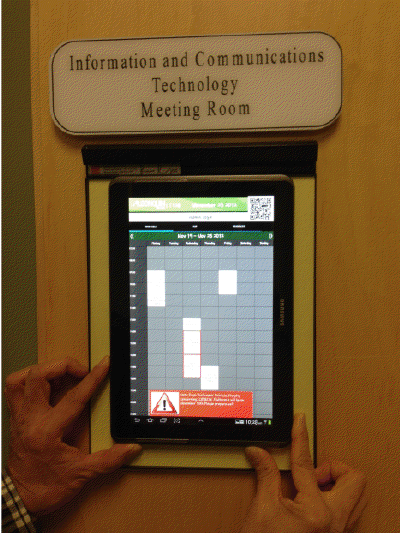 Photograph: The Classroom Portal application running on a wall-mounted tablet at Algonquin College.